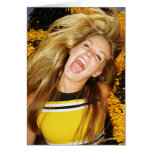 Cheerleader flipping hair, laughing, surrounded