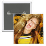 Cheerleader flipping hair, laughing, surrounded 2 inch square button