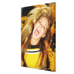 Cheerleader flipping hair, laughing, surrounded canvas prints