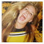 Cheerleader flipping hair, laughing, surrounded ceramic tile