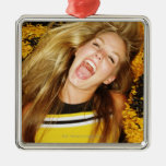 Cheerleader flipping hair, laughing, surrounded christmas tree ornament