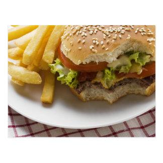Cheeseburger, bites taken, with chips postcard