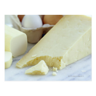 Cheeses and eggs. Eggs are rich in protein and Postcard