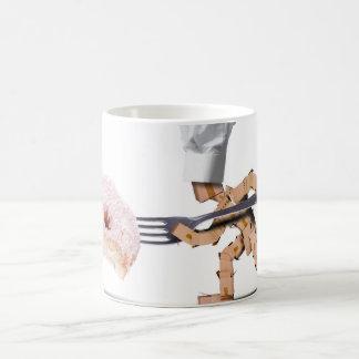 Chef box character attacking a large doughnut coffee mug