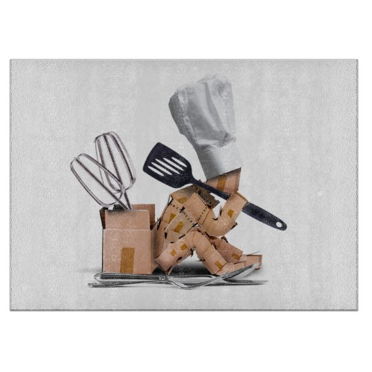 Chef character sat thinking with kitchen tools cutting board