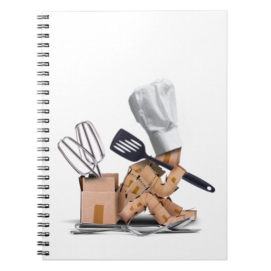 Chef character sat thinking with kitchen tools notebook