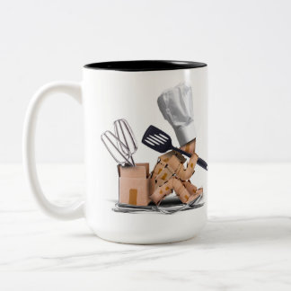 Chef character sat thinking with kitchen tools Two-Tone coffee mug
