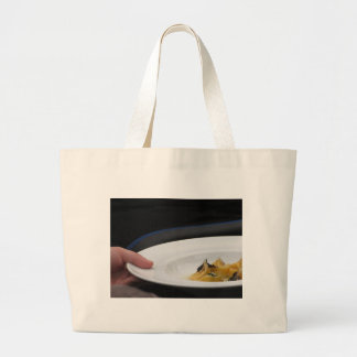 Chef holding cooked handmade Agnolotti to serve Large Tote Bag