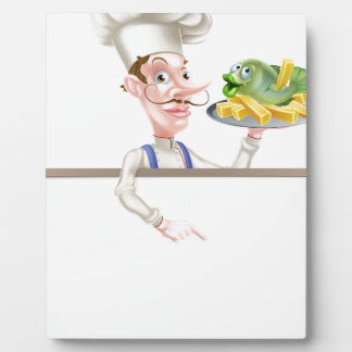 Chef Holding Fish and Chips Pointing at Sign Plaque