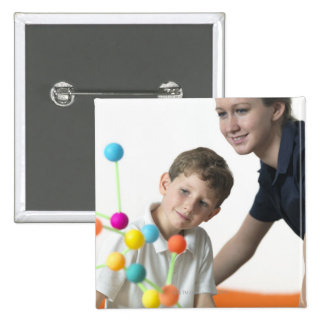 Chemistry lesson. 6 year old boy and his teacher 2 inch square button