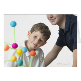Chemistry lesson. 6 year old boy and his teacher greeting card