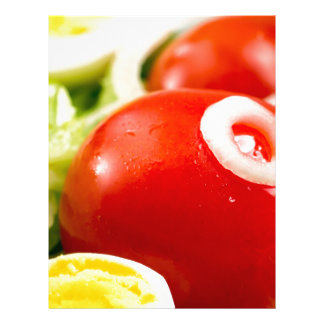 Cherry tomatoes and boiled eggs in a salad letterhead