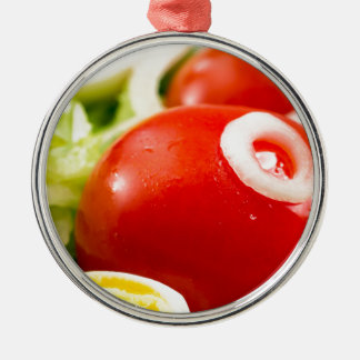 Cherry tomatoes and boiled eggs in a salad metal ornament