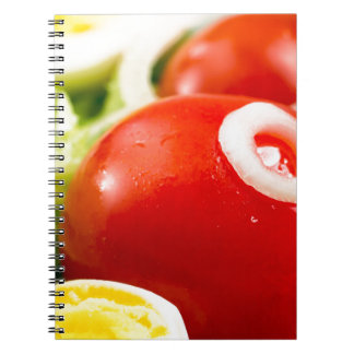 Cherry tomatoes and boiled eggs in a salad notebook