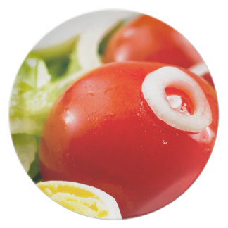Cherry tomatoes and boiled eggs in a salad party plate