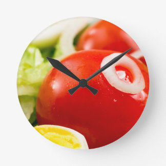 Cherry tomatoes and boiled eggs in a salad round clock