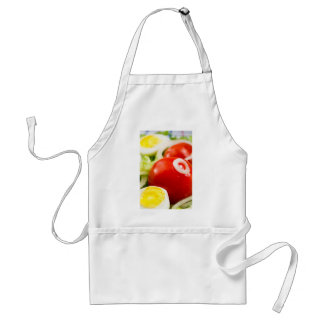 Cherry tomatoes and boiled eggs in a salad standard apron