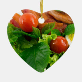 Cherry tomatoes, herbs, olive oil, eggs and bacon ceramic heart ornament