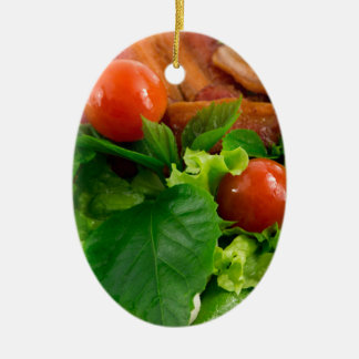 Cherry tomatoes, herbs, olive oil, eggs and bacon ceramic oval ornament