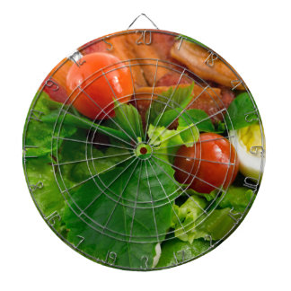 Cherry tomatoes, herbs, olive oil, eggs and bacon dartboard