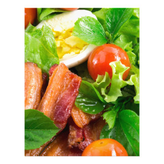 Cherry tomatoes, herbs, olive oil, eggs and bacon letterhead