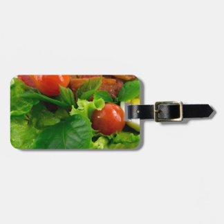 Cherry tomatoes, herbs, olive oil, eggs and bacon luggage tag