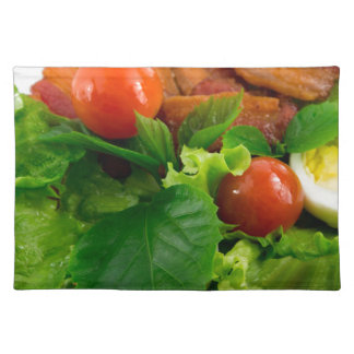 Cherry tomatoes, herbs, olive oil, eggs and bacon placemat