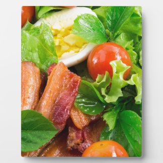 Cherry tomatoes, herbs, olive oil, eggs and bacon plaque
