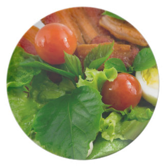 Cherry tomatoes, herbs, olive oil, eggs and bacon plate