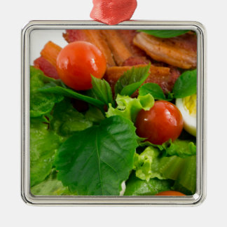 Cherry tomatoes, herbs, olive oil, eggs and bacon Silver-Colored square ornament