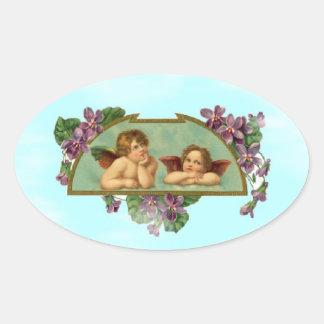 Cherubs Keeping Watch From Heaven Oval Sticker
