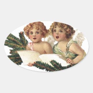 Cherubs Singing Carols Oval Sticker