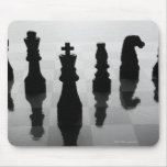Chess pieces on chess board in black and white mouse pad