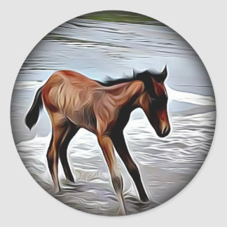 Chestnut Foal Playing in the Ocean round sticker