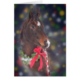 Cheval de Noël avec le bokeh de couleur Carte De Vœux