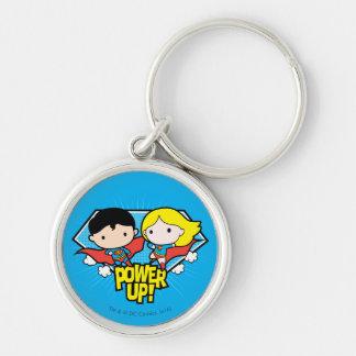 Chibi Superman & Chibi Supergirl Power Up! Silver-Colored Round Keychain