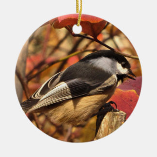 Chickadee Bird in Pink and Red Autumn Leaves Round Ceramic Ornament