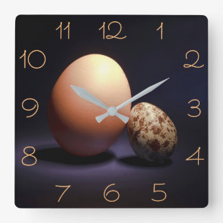 Chicken and quail eggs in love. square wall clock