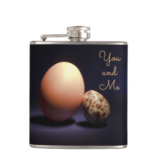 Chicken and quail eggs in love. Text «You and Me». Hip Flask