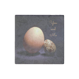 Chicken and quail eggs in love. Text «You and Me». Stone Magnets
