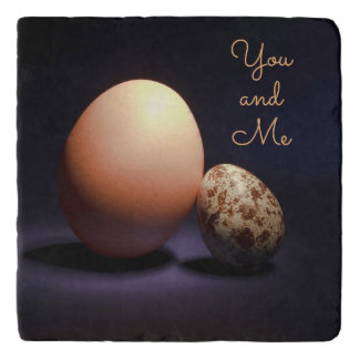 Chicken and quail eggs in love. Text «You and Me». Trivet