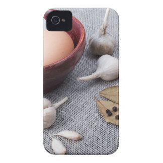 Chicken eggs and garlic and spices on the kitchen iPhone 4 covers