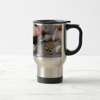 Chicken eggs and garlic and spices on the kitchen travel mug