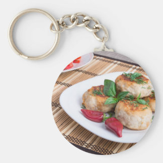 Chicken meatballs of minced meat and a salad basic round button keychain
