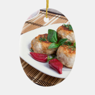 Chicken meatballs of minced meat and a salad ceramic oval ornament