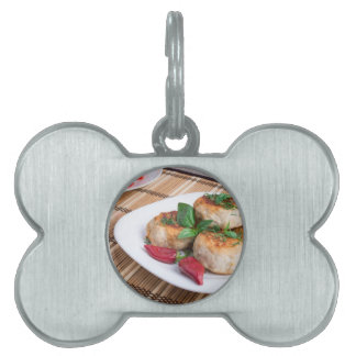 Chicken meatballs of minced meat and a salad pet ID tag