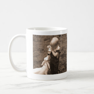 Child Feeding Goat Coffee Mug