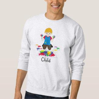 Child fingerpainting sweater