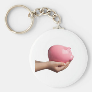 Child holding a piggy bank key chain