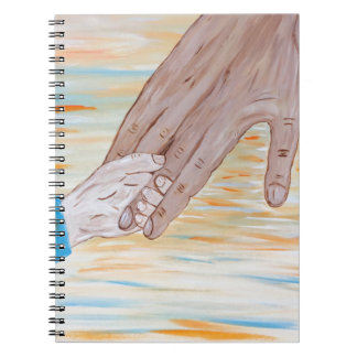 Child holding Father's hand Notebook